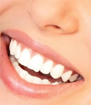 к чему снится зубы крошатся