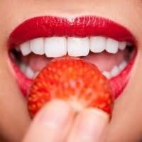 к чему снятся белые зубы